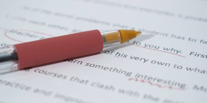image of a pen used to correct typing errors